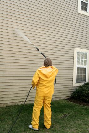 Pressure washing the siding of a house by Mars Painting.